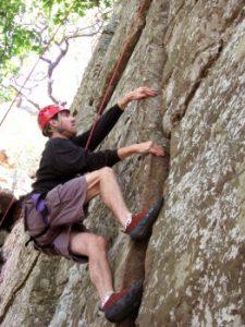 Man climbing a rock